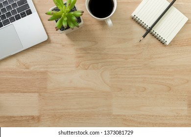 Flay lay, Top view office table desk with laptop, notebook, keyboard, coffee, pencil, leaves with copy space wood background.