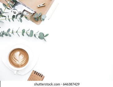 Flay lay, Top view office table desk. Feminine desk workspace frame with clipboard and coffee  on white background.  ideas, notes or plan writing concept