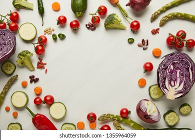 Flay lay with vegetables and seeds on white surface