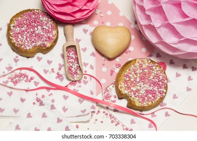 flay layout traditional pink muisjes, food for celebration the birth of a baby girl in the Netherlands.