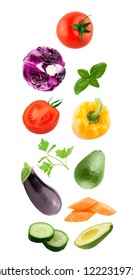 Flaying vegetables. Fresh flying cucumber, aubergine, tomato, peppers, carrot, avocado, basil and parsley vegetables ingredients isolated on a white background.