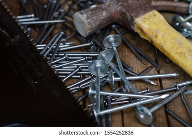 A flaylat of hammer, saw and nails over the wooden background
