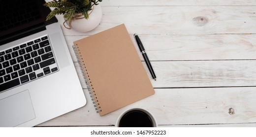 Flaylat workspace with laptop  on white wooden table with copy space, banner concept