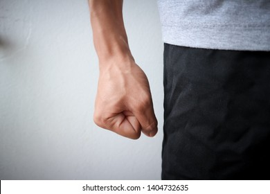 Flea angry man wearing a gray shirt and black pants emotionally angry anger of asian people and blood vessels at hand and white background texture objects