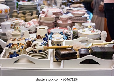 Flea market, antiquity market, different old things: plates, bowls, vases, home utensils on the flea market