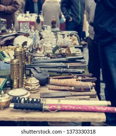 Flea market booth with many old items being sold.