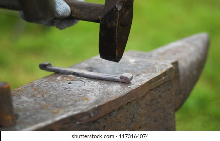 Flea market, folk crafts. Blacksmith for work, The tool forged. smith, farrier, forger, smithy, hammersmith