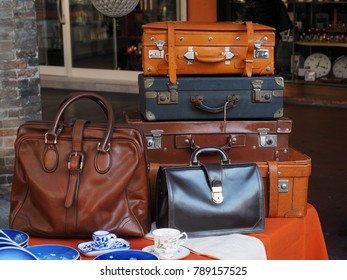 Flea market. Old suitcases and old leather bags for sale.