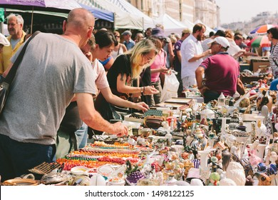 Flea Market Vienna At Naschmarkt. VIENNA, AUSTRIA, AUGUST 24, 2019: Local people and lots of tourists visit the market and looking for bargains and antique stuff.