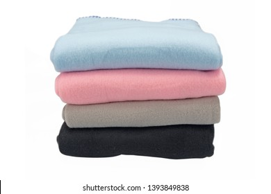 Fleece bedspreads. Four colors. Stack of covers. Isolated image on white background.