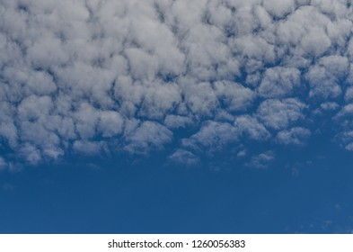 fleecy clouds with blue sky