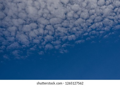 fleecy clouds in the sky in summer