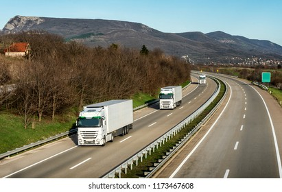 Fleet or convoy of trucks in line on a country highway