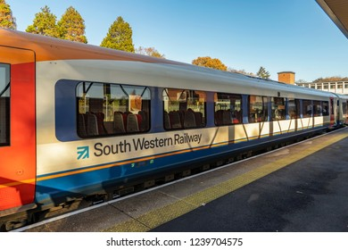 Fleet, Hampshire, UK. 18th November 2018. South Western railway Class 444 express train about to depart for Basingstoke and the South coast
