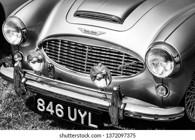 Fleet, Hampshire, UK – June 05 2016: The front of a 1960 Austin Healey on display at a car show