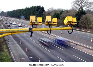 Fleet, Hampshire, UK - March 11th 2017: Average speed cameras in operation on the M3 Motorway with intentional motion blur on vehicles