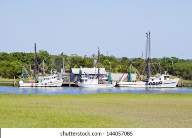 A fleet of southern fishing boats moored at their home dock on the coast.