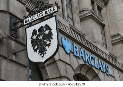 Fleet Street London 24 July 2016; Barclays bank old hanging street sign and modern logo next to it.
