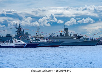 Fleet. Warships are in service.Military cruiser.Naval forces. Protection of maritime borders. Flotilla.Navy.Protection of maritime communications. Warships are in service.Warships decorated with flags