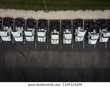 Fleet of white 18wheeler