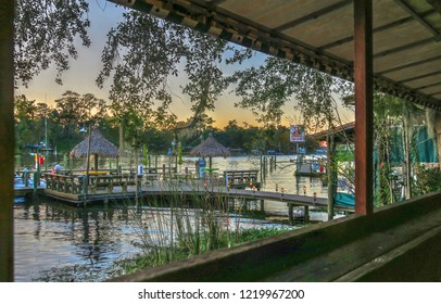 Fleming Island, Florida / USA - November 22, 2016: Whitey's Fish Camp Restaurant View of Doctor's Lake and Docks at Dusk