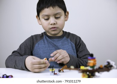 Flemington New Jersey, USA - January 2018. creative child constructs with latest Star Wars lego.  happy kid playing legos at home.