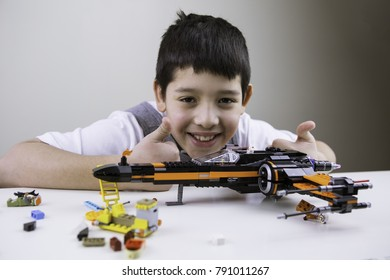 Flemington NewJersey, USA - January 2018. Teenage boy plays with lego Star Wars. Teenager playing legos.