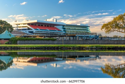 The Flemington Racecourse grandstands reflecting in the Maribynong River in Melbourne, Australia