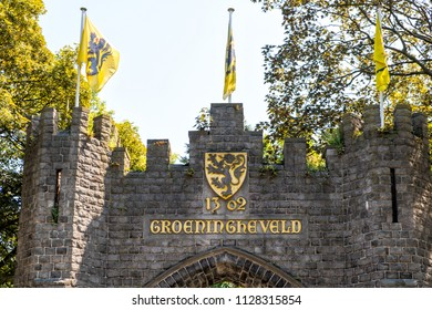 Flemish Lion flags on top of the Groeningegate (1906) at the former Groeningefield where the Battle of the Golden Spurs (Guldensporenslag) was fought July 11 1302. Kortrijk, Flanders, Belgium