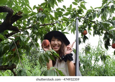 Flesh fruit picking girl at outer place