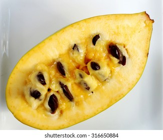 Flesh, pulp and seeds of the common pawpaw fruit (asimina triloba), also called custard apple