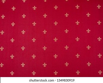 Fleur-de-lis Pattern painted on a red wall. Luxury vinous red and yellow vintage classical