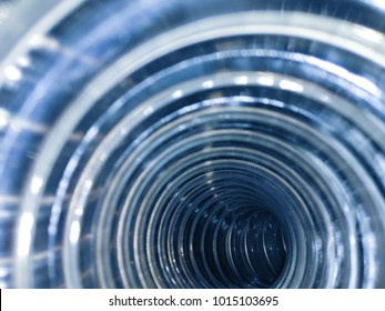 Flexi air hose, plastic flexible tube, piping on an abstract background.