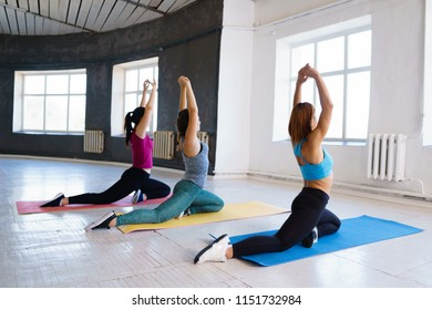 Flexibility, grace, good mood, healthy lifestyle,vitality, yoga. Pilates group workout for women. Sporty ladies stretching in gym