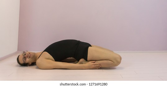 flexibility training, stretching the quadriceps in the upper legs, LGBT transgender girl working out