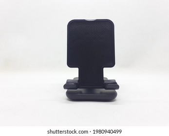 Flexible Black Table Holder for Tablet and Mobile Phone in White Isolated Background