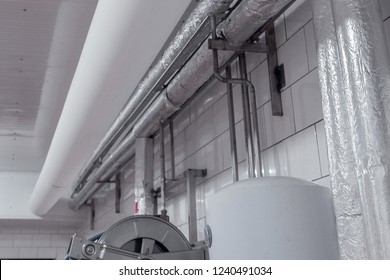 Flexible fabric or pvc like DuctSox ductwork installed in the clean facility. Milk processing plant.