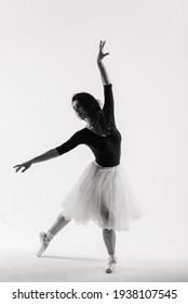 Flexible female, ballet dancer in black bodysuits, ballerina