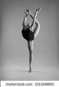 Flexible girl in black bodysuits