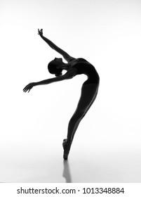Flexible girl in blacklight