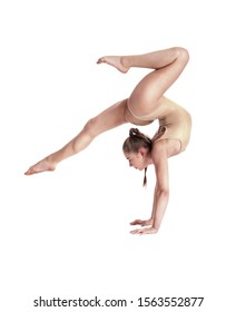 Flexible girl gymnast in beige leotard is performing complex elements of gymnastics while posing isolated on white background. Close-up.