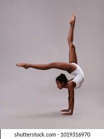 Flexible girl in white leotard