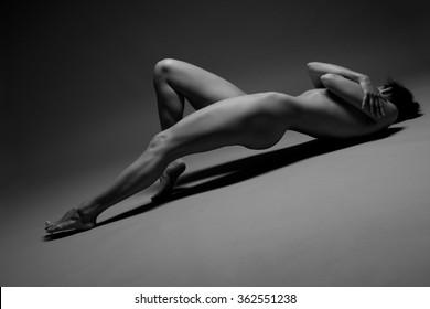 flexible girls nude photos over dark background