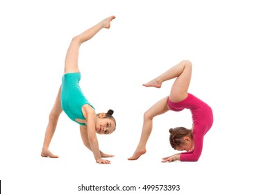 Flexible kids gymnasts doing acrobatic feat, isolated on white background. Sport, active lifestyle concept