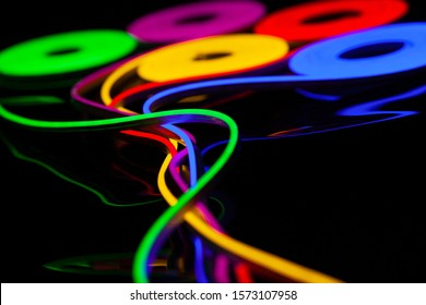 Flexible led tape neon flex in different colors on black background