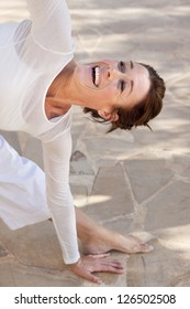 A flexible middle age senior woman doing yoga