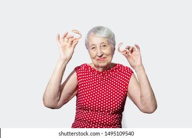 flexible nylon denture on senior female hands. Removable dentures flexible, devoid of nylon, hypoallergenic exempt from monomer