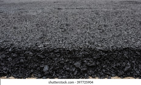 In flexible pavements, the upper layer consists of asphalt concrete, that is a construction aggregate with a bituminous binder. The wearing course is typically placed on the base course