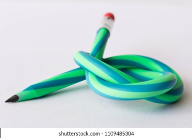 Flexible pencil . Isolated on white background .