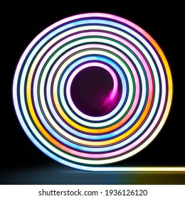 Flexible RGB led tape neon glowing on black background.